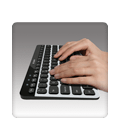 Hands typing on Bluetooth Easy-Switch Keyboard