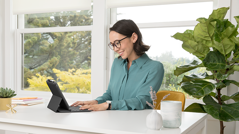 Woman working from home on an iPad with a keyboard case